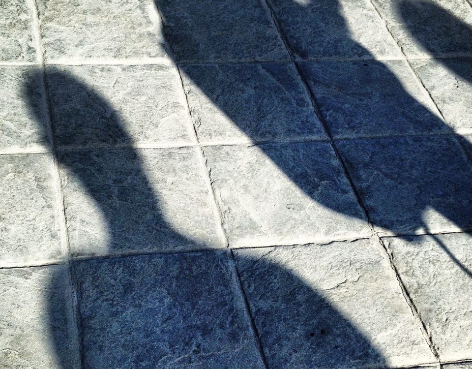 Photo of people shadows on paving stones