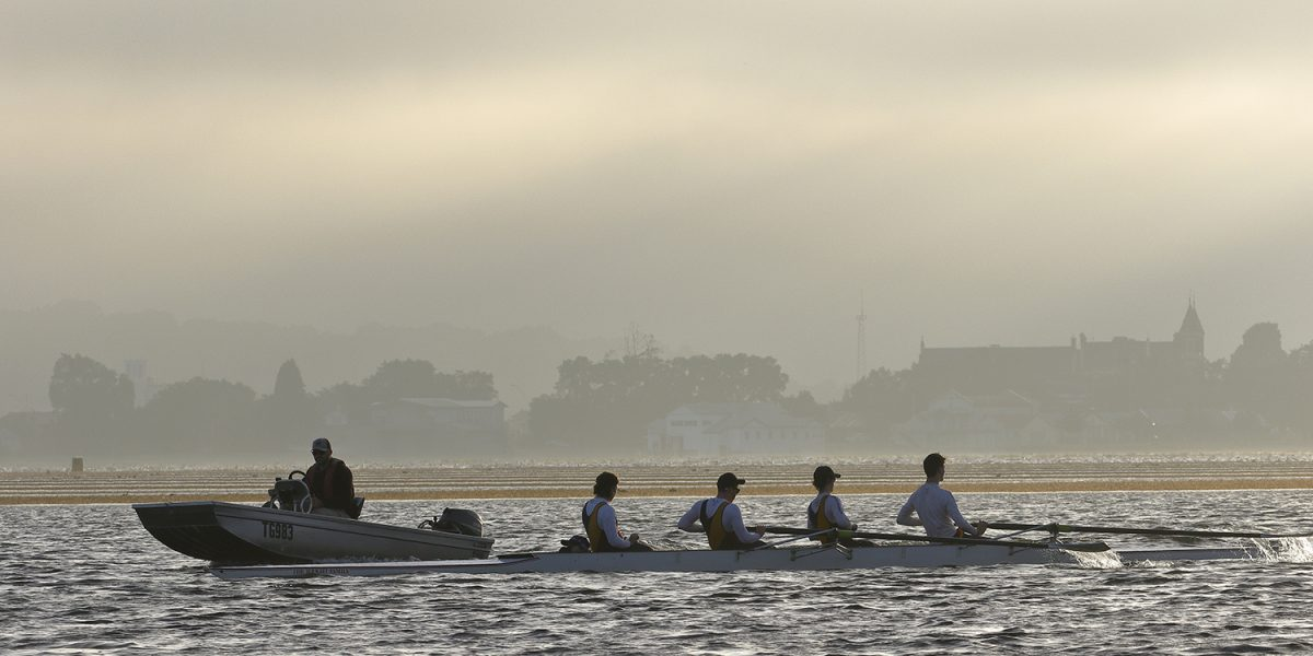Photo of river rowers with their coach